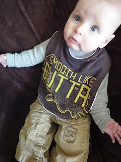 Baby wearing graphic tee shirt bib