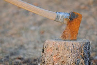 axe in tree stump