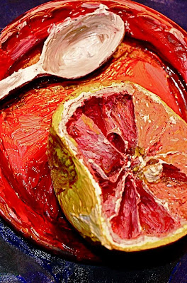 real life grapefruit painted to resemble a painting