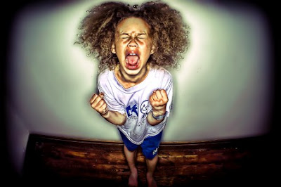 seven year old girl throwing a temper tantrum