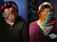 two women wearing multicolored scarves to hide their faces, like robbers