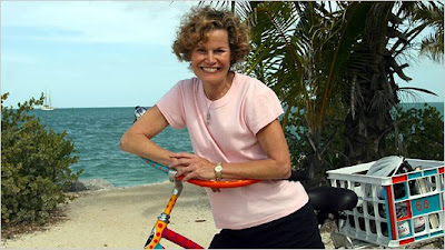 Judy Blume with bicycle at beach