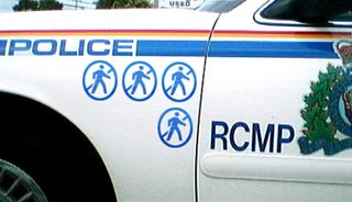 photo of RCMP car with marks for pedestrian hits