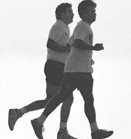 Two men jogging, black and white photo.