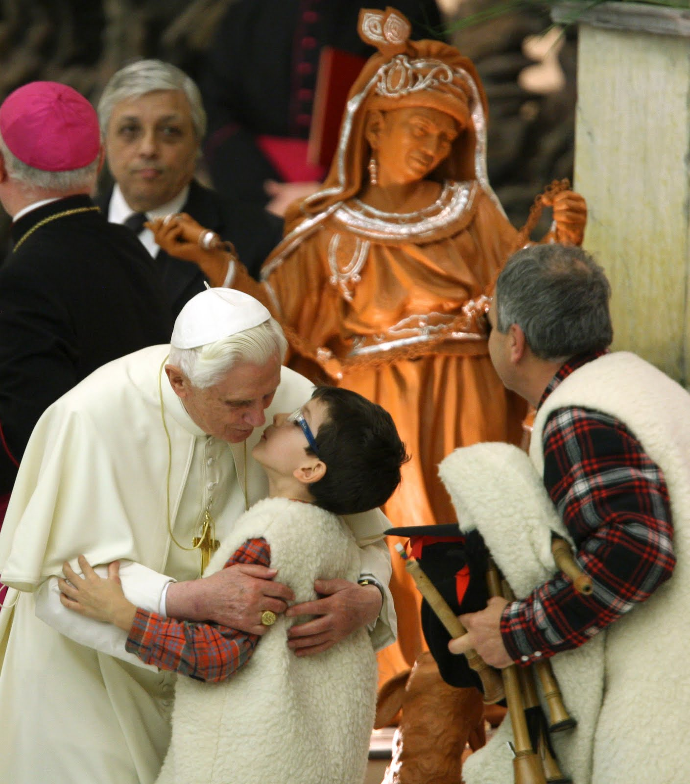 Pope kissing child on lips