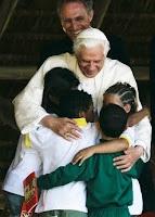 [Image: pope+benedict+brazil+hugging+children+ch...ocrisy.jpg]