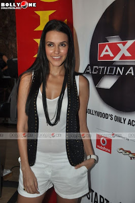 Neha Dhupia with black glasses