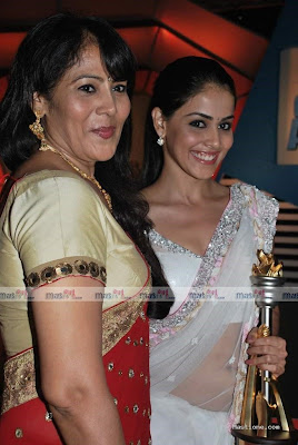 Genilia was wearing a transparent sari in this award.