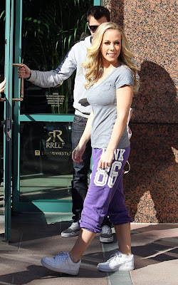 Kendra Wilkinson arriving at an office building with her assistant