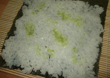 Rice and wasabi paste laid out on a nori sheet