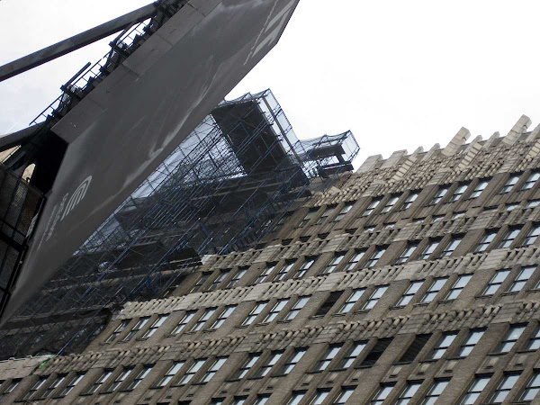 Ominous Black Form - A billboard in fact, nowhere near the scaffolding, on Broadway at 37th.