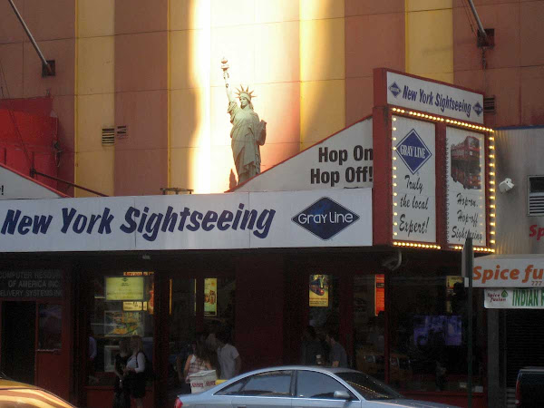 New York Sightseeing - And Miss Liberty, lost in the light on 8th Ave. near 47th St.