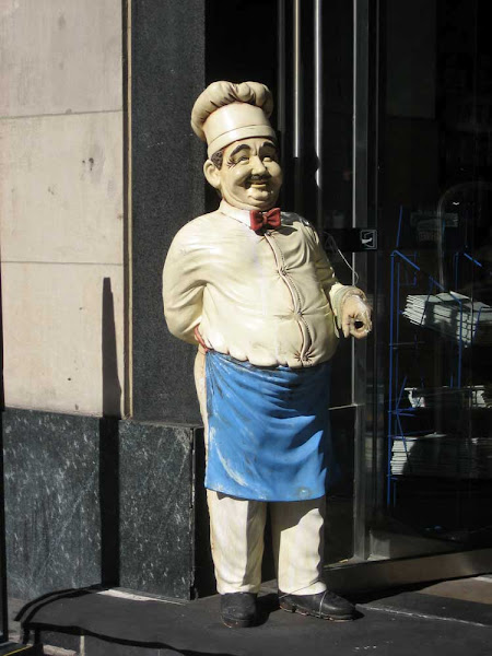 Rude Chef - A sidewalk chef (on 5th Ave. near 30th St.) makes a gesture with his left hand that's bound to be an insult somewhere.