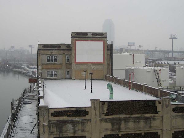 Snowy Blank Sign - At an oil facility on the Queens side of the Greenpoint Ave. bridge over Newtown Creek.