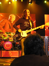 Geddy Lee as photographed by Reg
