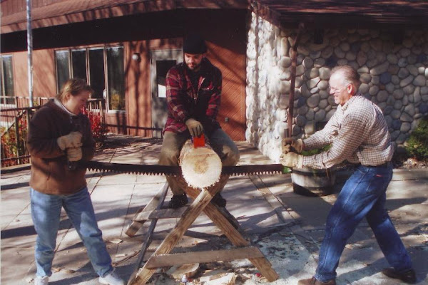 Jay & Linda using the crosscut saw at Camp Forest Springs (11-07)