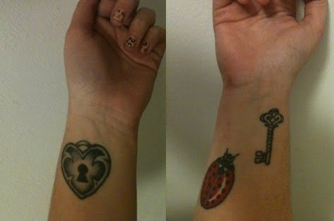 My most recent tattoos are the matching heart locket and key you can see