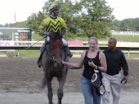 Seattle Smooth into the winners circle with jockey Jose Lezcano after winning the Cotillion at Philadelphia Park, 2008
