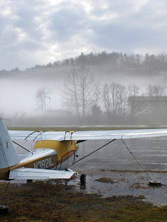 mist and small plane