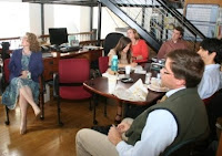 Attendees of a Brown Bag lunch listen attentively to a guest's presentation