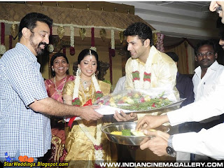 Tamil actor Kamal hasan  presenting a bouquet