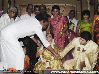 Tamil actor Rajini kanth shaking handing with the bridegroom