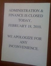 Closed sign on door to Administration and Finance
