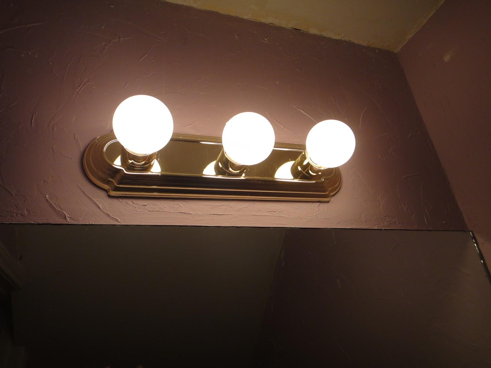 Bathroom Vanity Light With Power Outlet thrifty little blog: september 2010