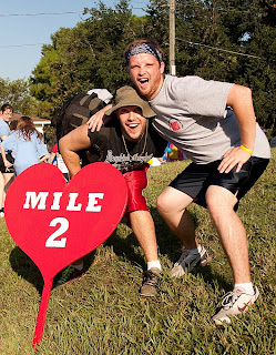 VCC students, Dylan Anderson and Dylan Morley pose in front of the Mile 2 marker of the 3.1 mile track.