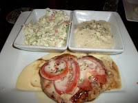 Click to enlarge - Chicken Fresco, a chicken breast topped with vine ripened tomatoes, lemon butter sauce and a drizzle of balsamic vinaigrette.