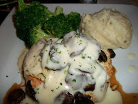 "Click to enlarge - Chicken Bella, ""Sautéed baby portabella mushrooms and artichokes in a Parmesan cream sauce over a fresh, grilled chicken breast"