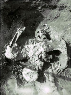 The body of one of the Sasanian attackers lay in the mine, still clad in his iron mail shirt, his helmet and sword near his feet. (Please credit as follows: Yale University Art Gallery, Dura-Europos Excavation Archive).