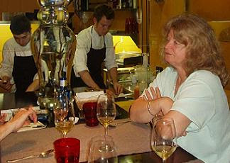Aidan's mother Liz enjoys a glass of wine as he helps prepare dinner