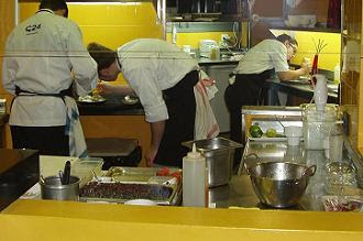 Fantastic concentration in the kitchen as each chef makes their contribution