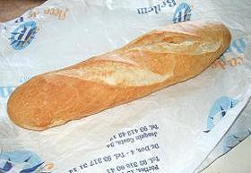 A fresh white baguette from the market or local baker