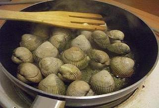 Cooking the cockles in butter and Amaretto