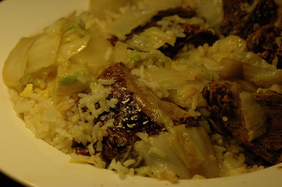 Roast duck with rice and a side order of Chinese white cabbage in oyster sauce