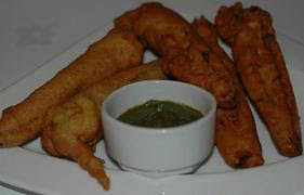Baingan pakoras of aubergine and haldi