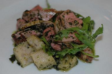 A succulent and delicious dish of lamb, bread and green sauce