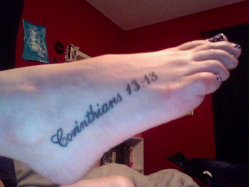 "wrist is a new tattoo saying ""Timothy 4:12"". This is her favorite bible"