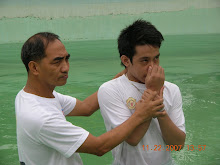BRO. MOISES BAPTIZES ONE OF TEN