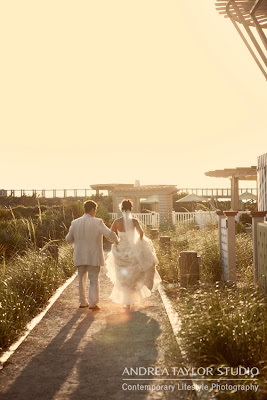 bride and groom leave beach ceremony sunset