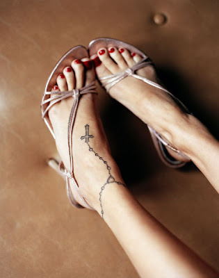 tattoos on foot and ankle. Nicole Richie rosary tattoo in
