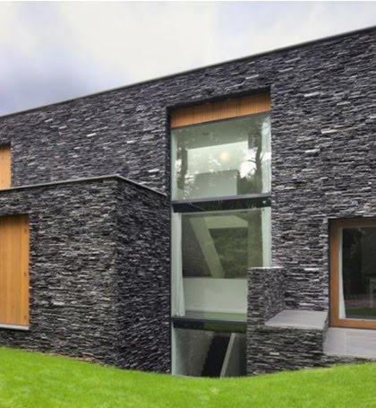 Cyclinghistory fachada de casa con piedras oscuras - Piedra rustica para fachadas ...