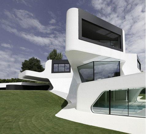 FACHADA DE CASA MINIMALISTA Casa Dupli por J Mayer H Arquitectos