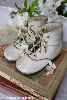 Old pair of white baby shoes