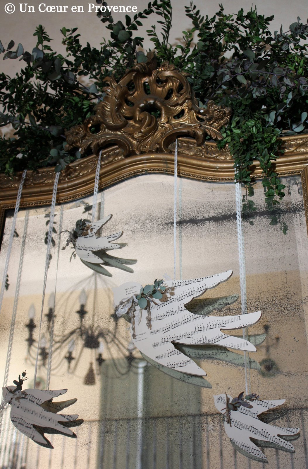 Swallows in carved wood hanged on a old mirror