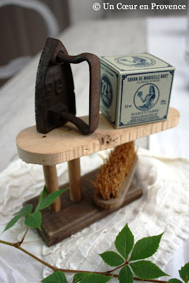 A doll's wooden sleeve board with an iron found and a tiny brush