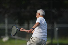 senior playing tennis