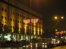 lit up menorahs in street